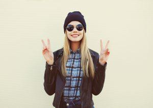 Fashion portrait of pretty blonde girl in trendy rock style